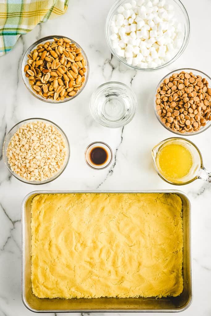 Overhead image of raw cake mix crust in cake pan