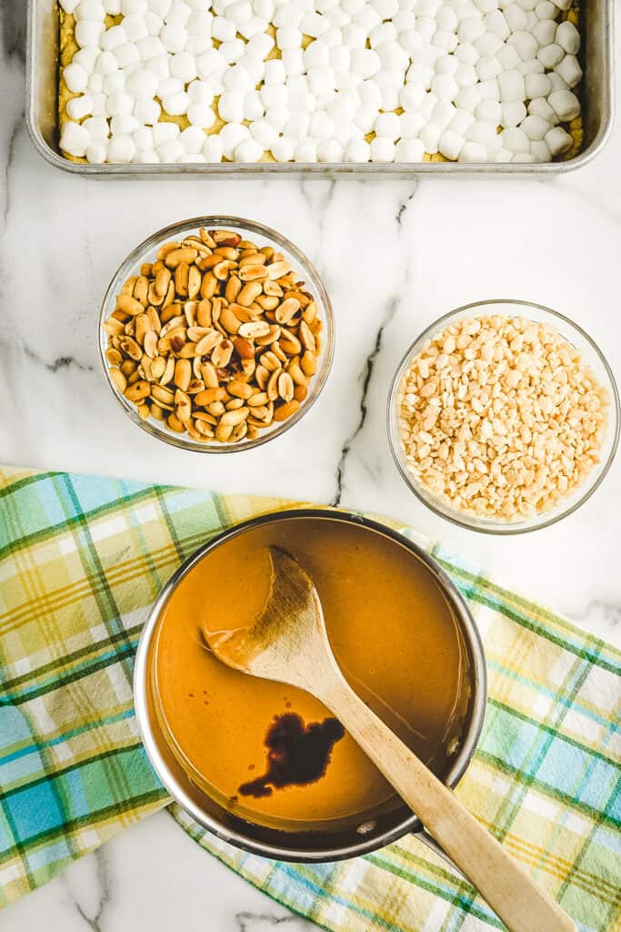 Overhead image of saucepan with melted peanut butter mixture and vanilla