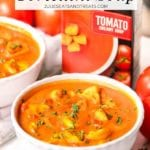 Tomato tortellini soup in a white bowl