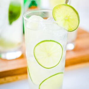 Paloma Drink in a glass with lime slices
