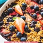 Pinterest Image for Berry Baked Oatmeal with text overlay on bottom with recipe name with pink background a main picture of berry baked oatmeal