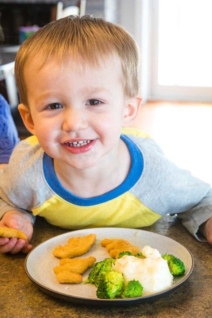 Child with dinner on plate