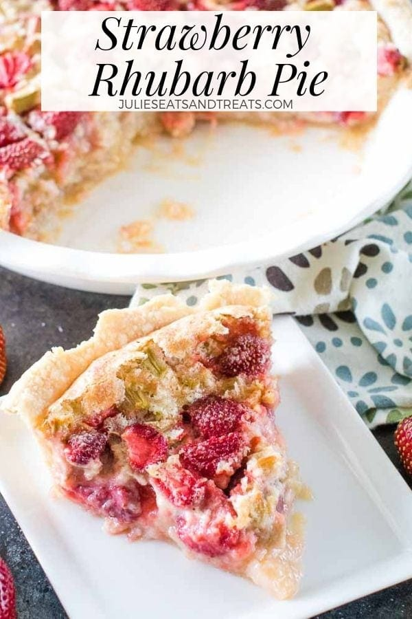 Slice of strawberry rhubarb pie on a white plate