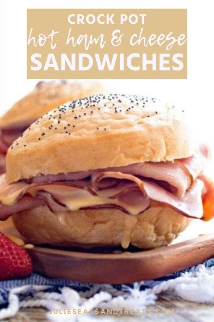 Hot ham and cheese sandwich on cutting board