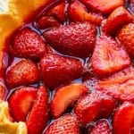 Whole Strawberry Pie on a white and green plate