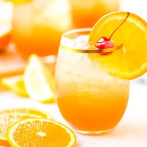Amaretto Sour in glass with a cherry and an orange slice