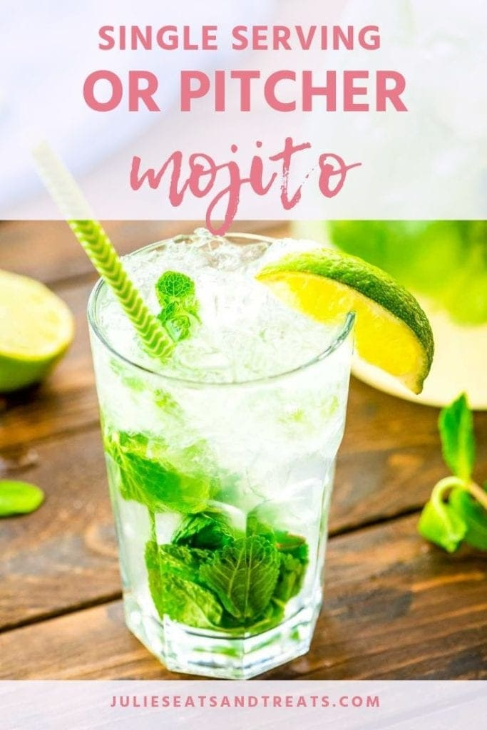 Mojito in a glass with mint, lime wedge, and a green straw