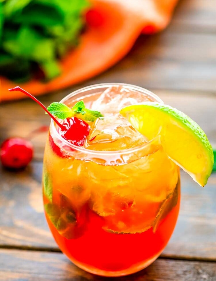 Mai Tai Drink in glass with a lime wedge and cherry