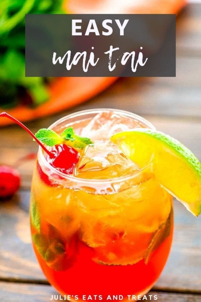 Mai tai cocktail in a glass with a lime wedge and cherry