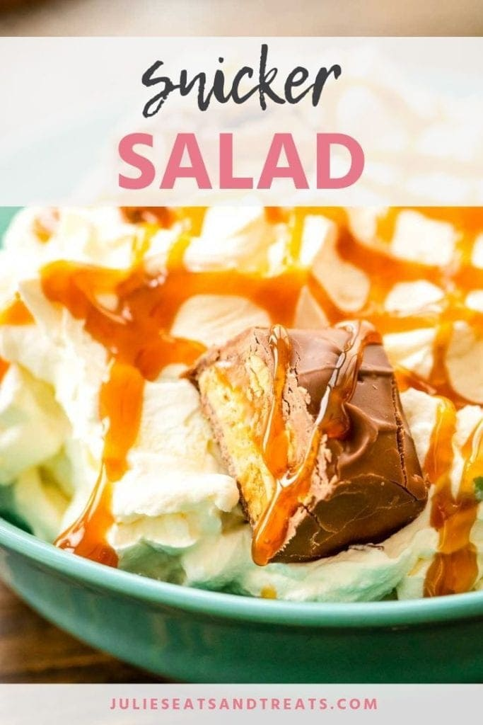 Snicker salad in a blue bowl topped with snicker chunks and caramel sauce