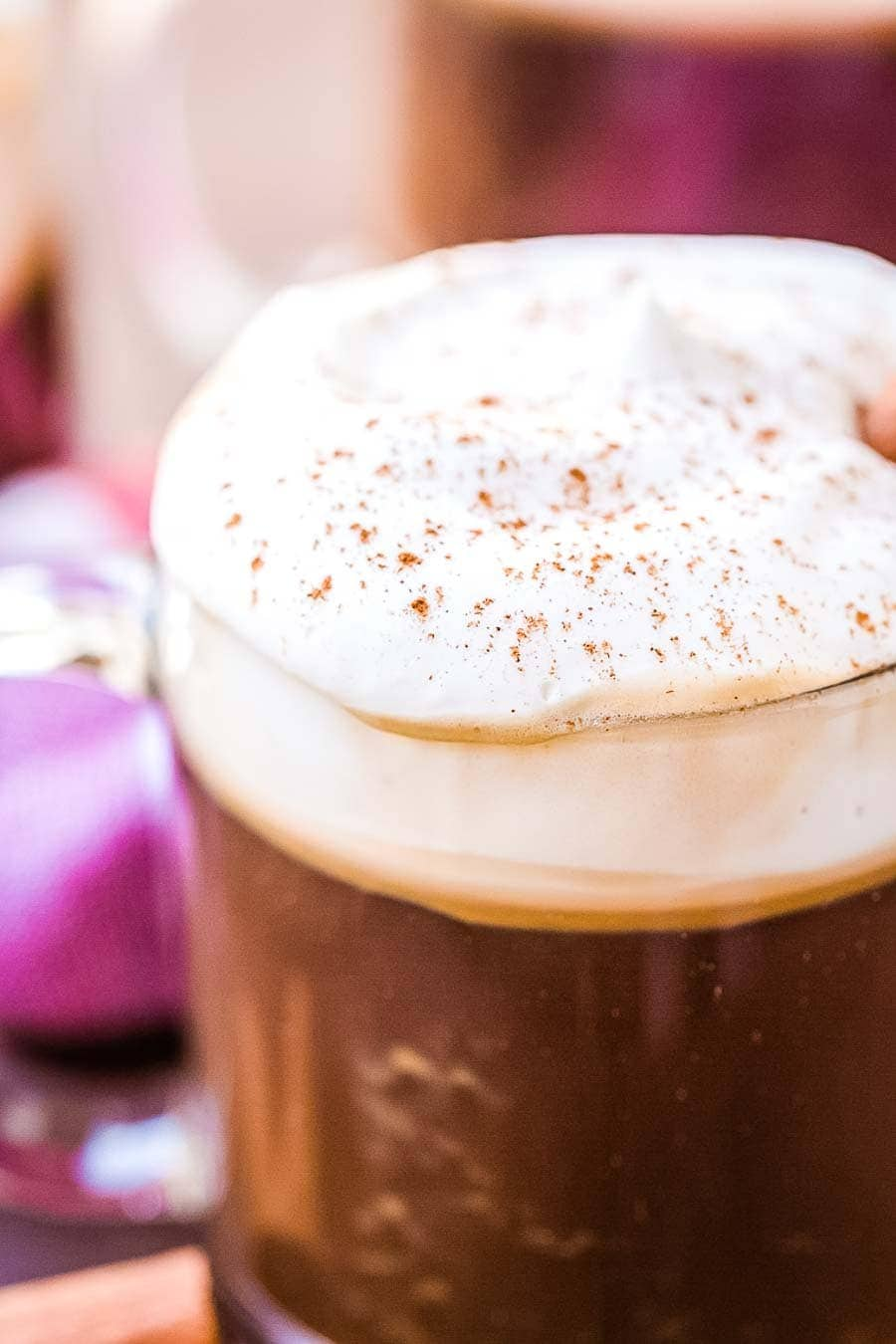 Easy close up of a coffee mug with coffee cocktail topped with whipped cream
