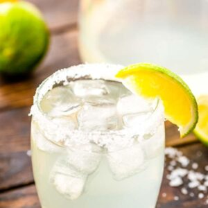 Margarita in a glass with salt and lime wedge on the rim