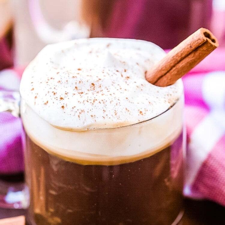 Irirsh Coffee with a cinnamon stick in glass mug