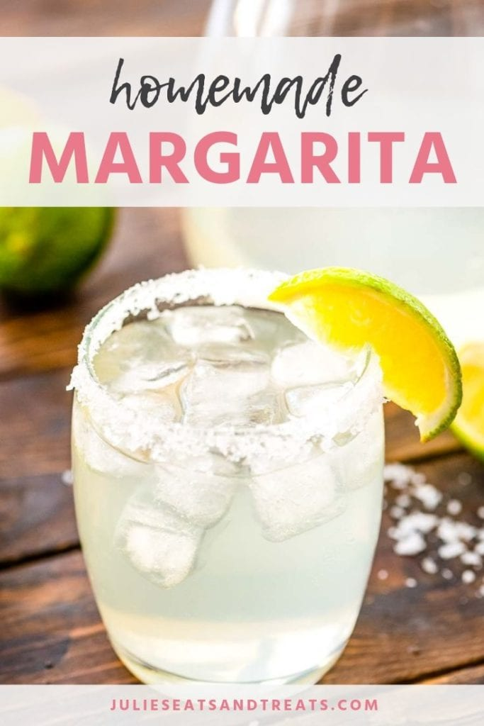 Margarita in a glass with salt and a lime slice on the rim