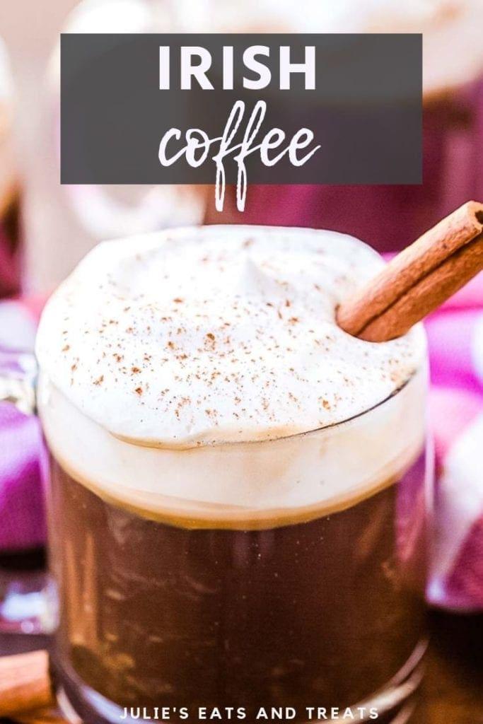 irish coffee with a cinnamon stick in a glass