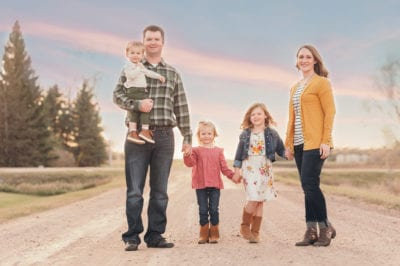 Picture of Jason, Julie, and their three kids on a gravel road