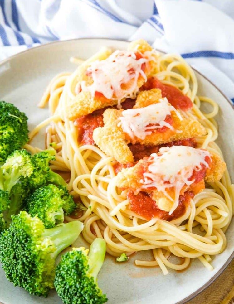 Chicken Parmesan with Dino Buddies Plated next to broccoli