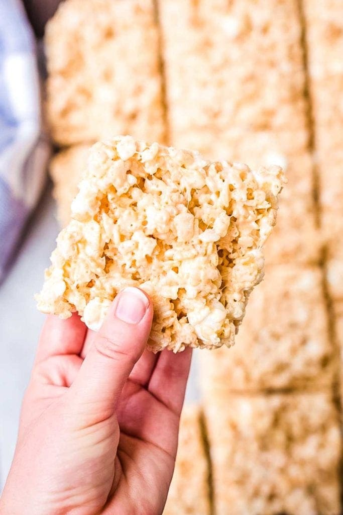 rice krispie treats bar in hand