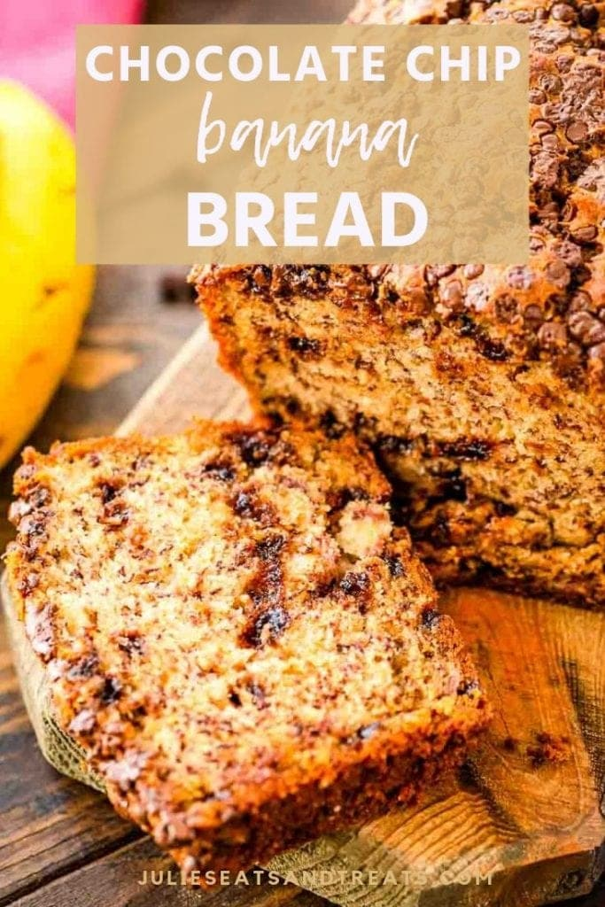 Chocolate chip banana bread on a cutting board with one slice cut off the end