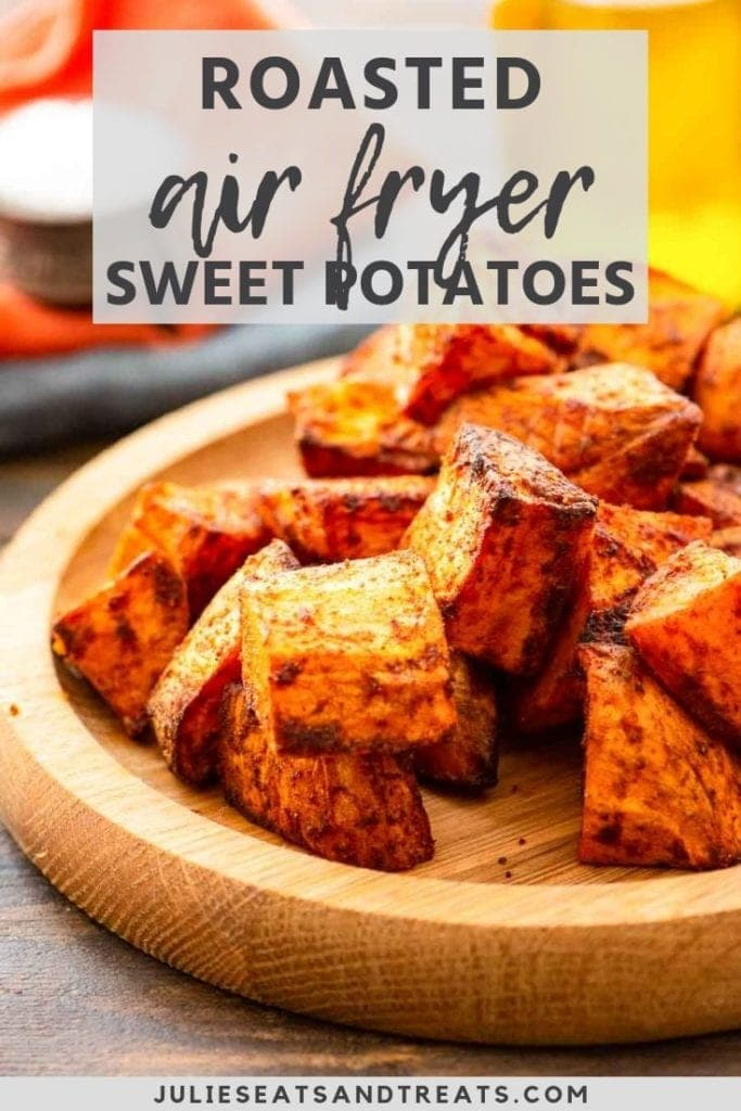 Roasted air fryer sweet potatoes on a wood plate