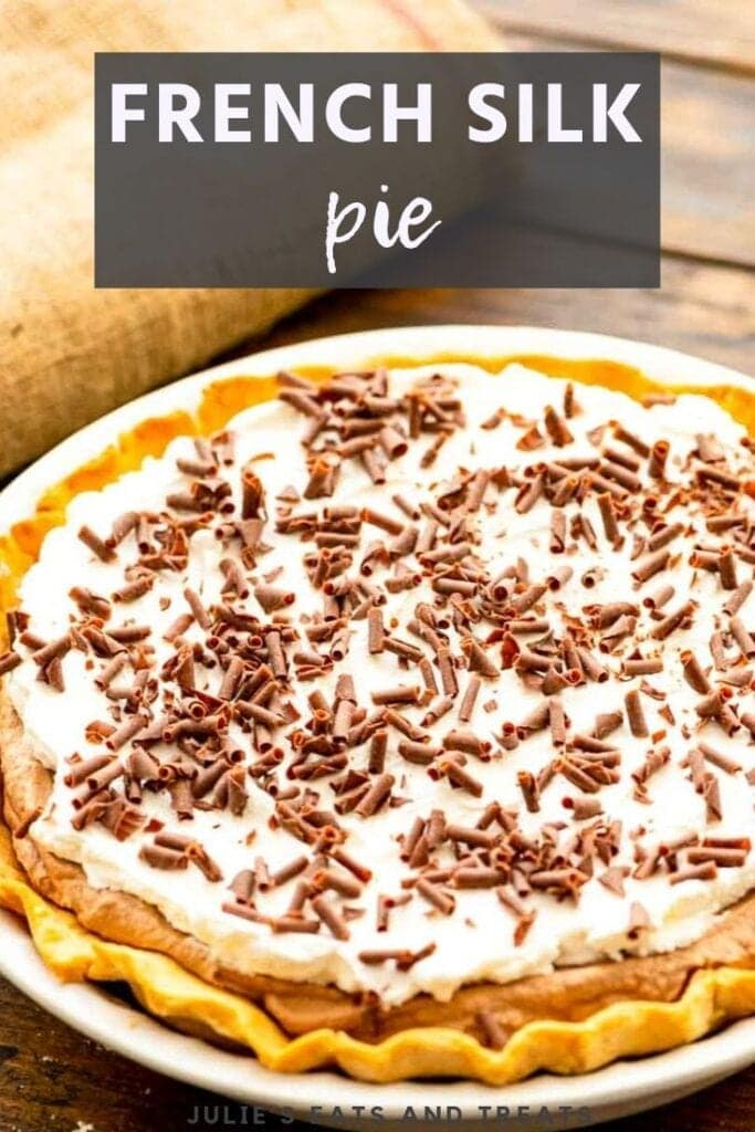 Whole french silk pie topped with chocolate shavings in a pie plate