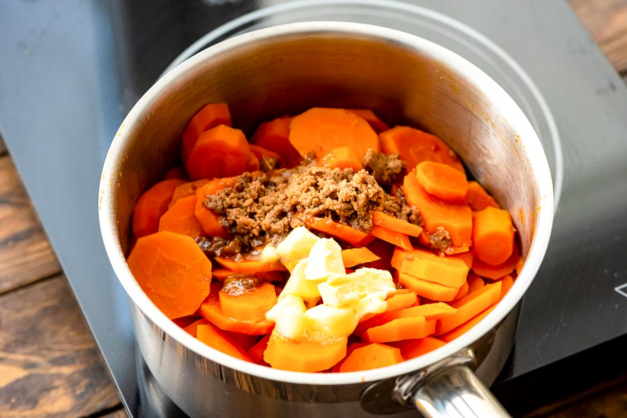 Saucepan with carrots, butter and brown sugar