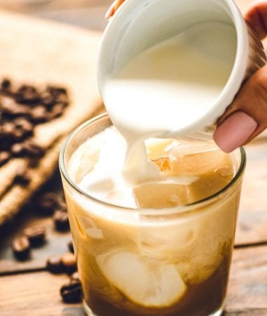 Cream being poured into White Russian cocktail