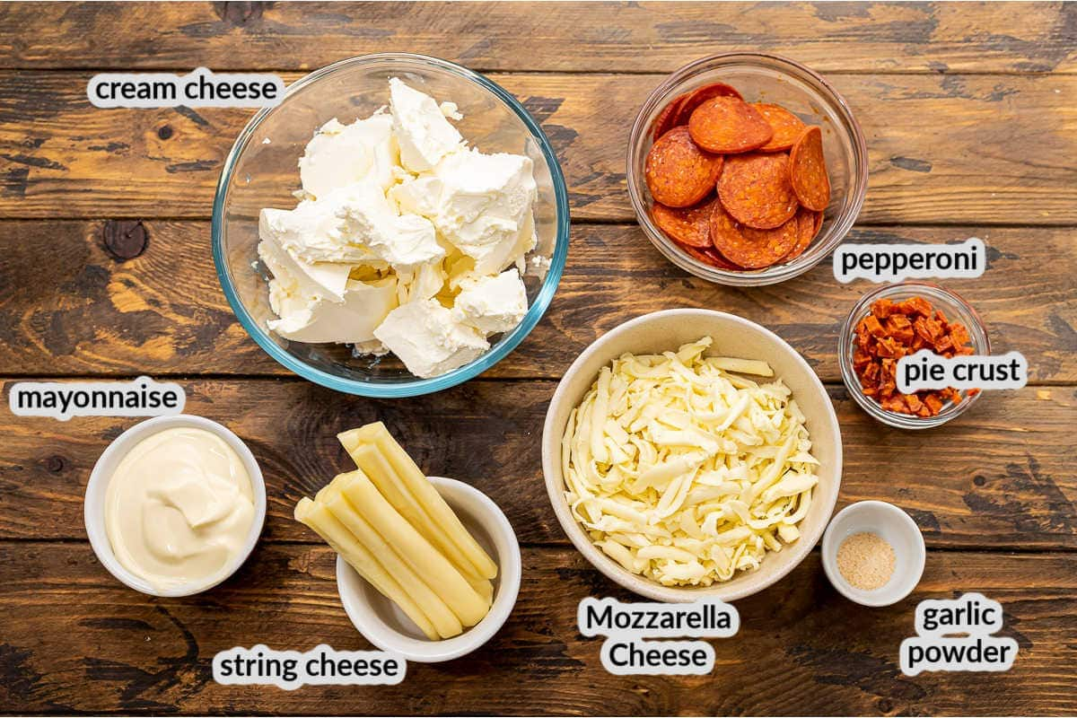 Overhead image of Pepperoni Pizza Dip Ingredients on wooden background