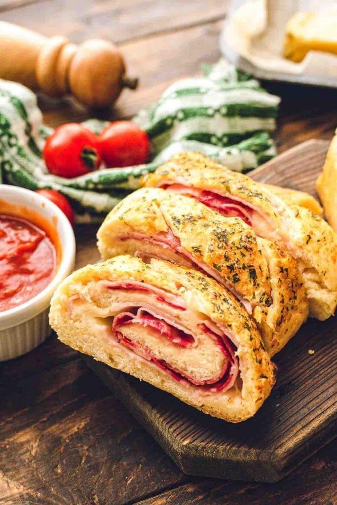Sliced Stromboli on cutting board