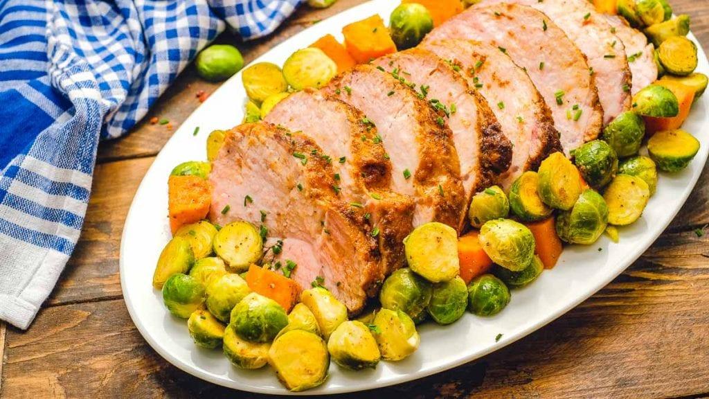 Pork Loin Roast and vegetables on white platter