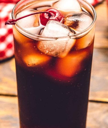 Roy Rogers Drink in glass with ice and a cherry