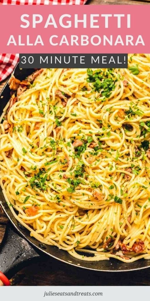 Skillet of spaghetti alla carbonara topped with parsley