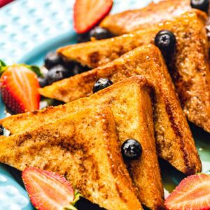 French toast with fruit on plate
