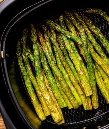 Roasted Asparagus in black air fryer basket