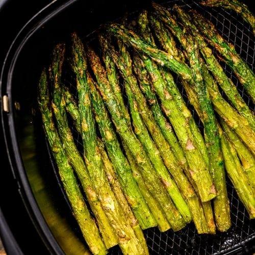 Roasted Asparagus in black air fryer basket