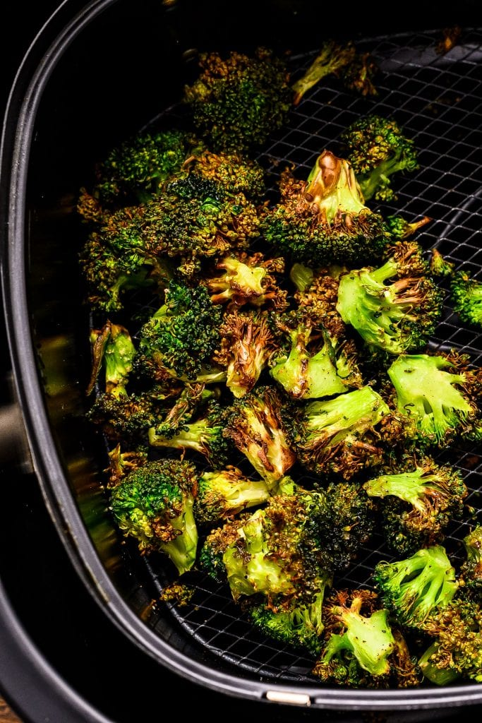 Air Fryer basket with roasted broccoli