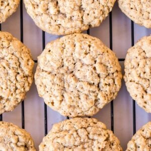 Oatmeal Cookies on wire rack with parchment paper under it