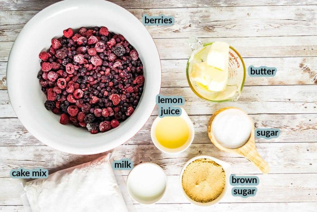 Ingredients for cobbler like berries butter lemon juice sugar brown sugar