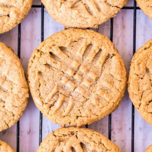 Peanut Butter Cookies on cooling rack with criss crosses on top