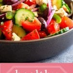 Pinterest Image for Greek Salad with photo of salad in a bowl on top and text overlay with recipe name on bottom with pink background