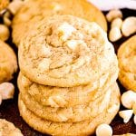 Stack of White Chocolate Macadamia Nut Cookies with more cookies laying next to it