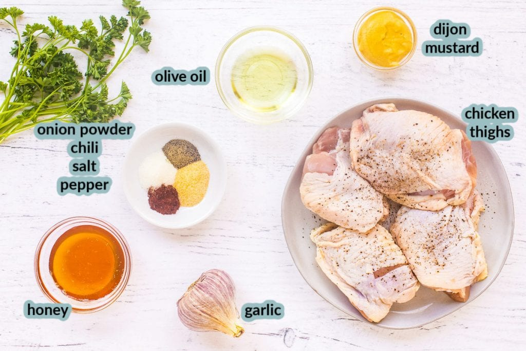 Ingredient for baked chicken thighs like chicken olive oil mustard spices honey garlic on white background