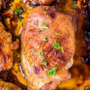 Overhead Image of baked chicken thighs in pan with drippings