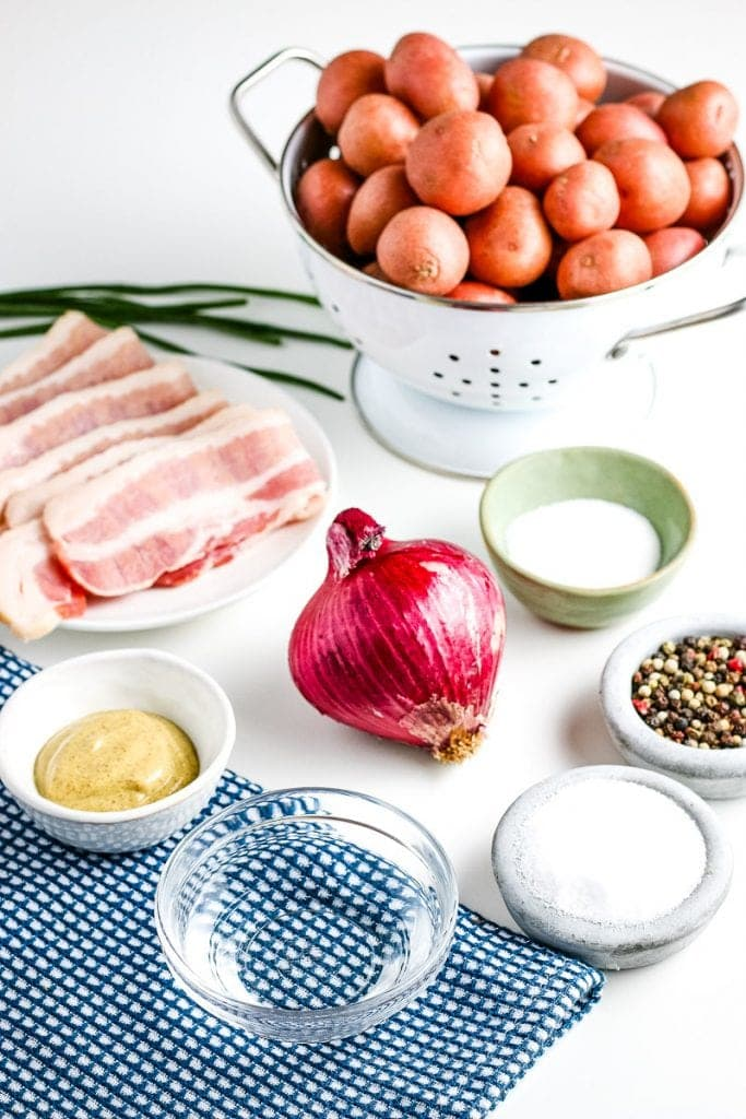 Image showing ingredients for German Potato Salad including onion, bacon, red potatoes, salt, pepper and more.