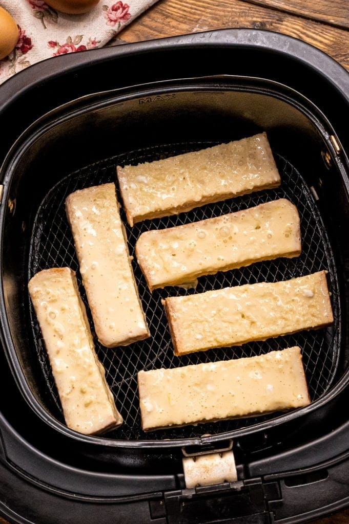 Battered slices of bread in air fryer basket