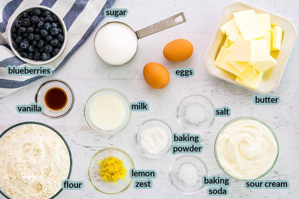 Ingredients needed to make blueberry muffins like butter eggs blueberries flour and more