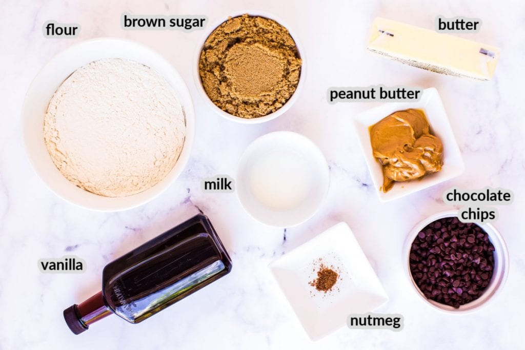 Overhead image showing ingredients to make Edible Cookie Dough. Ingredients shown are flour, brown sugar, butter, peanut butter, milk, chocolate chips, nutmeg and vanilla.