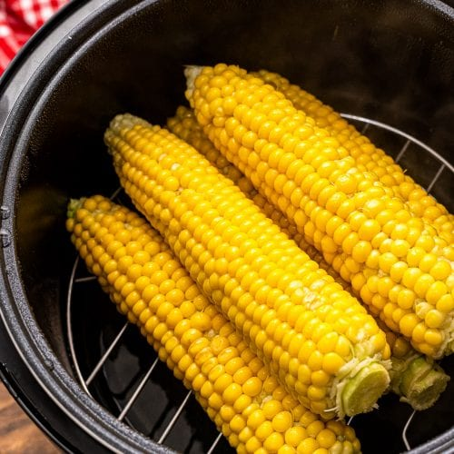 Corn on the cob in a pressure cooker.