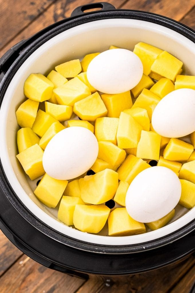 Instant Pot filled with raw potatoes and eggs before cooking