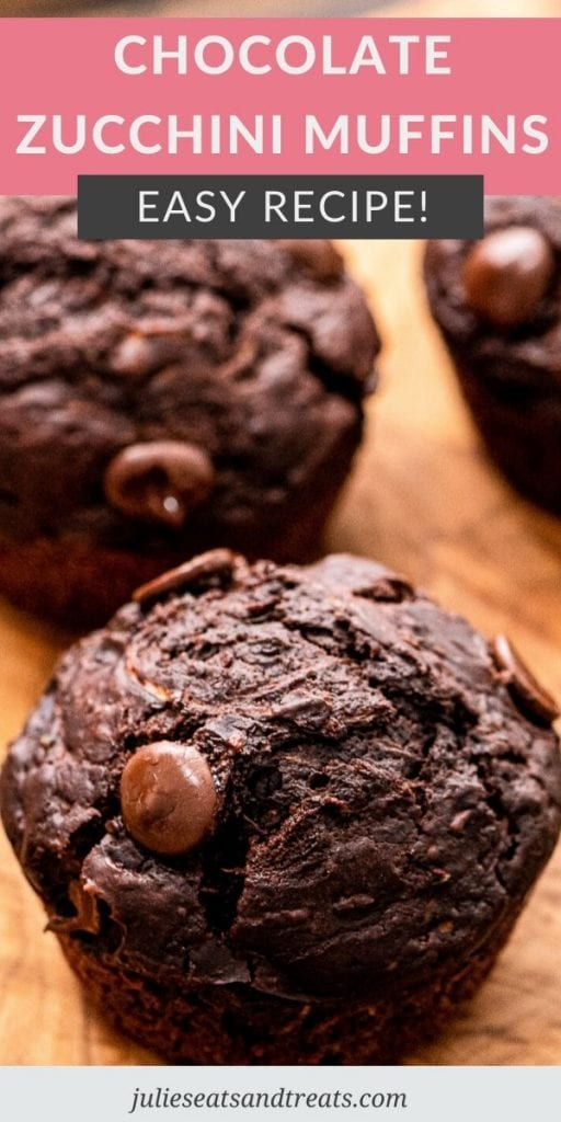 Pin Image with text overlay of Chocolate Zucchini Muffins on top and a photo of muffins below it on wood background.